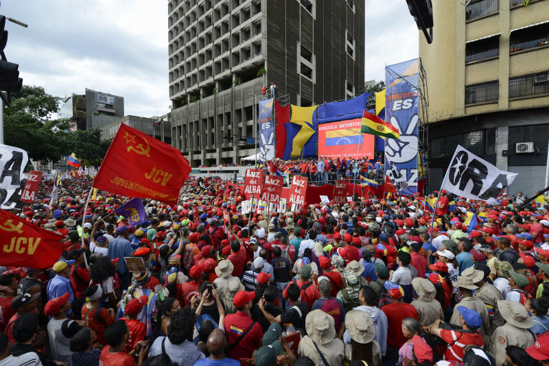 Hundreds gather for a pro-government rally in Caracas, Venezuela, Saturday, Nov. 16, 2019. Nicolas Maduro's socialist party called its members to demonstrate in solidarity with Bolivia's Evo Morales, who resigned the presidency and fled into exile in Mexico on Nov. 10, claiming a coup d'etat following massive protests accusing him of engineering a fraudulent reelection. (AP Photo/Matias Delacroix)
