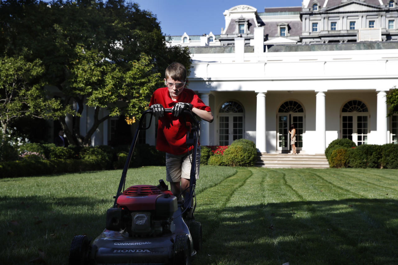 Frank Giaccio, 11, of Falls Church, Va., is focused as he mows the lawn of the Rose Garden, Friday, Sept. 15, 2017, at the White House in Washington. The 11-year-old wrote President Donald Trump requesting to mow the lawn at the White House. (Photo: Jacquelyn Martin/AP)