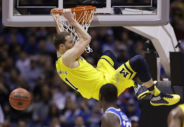 Michigan's Nik Stauskas dunks during the second half of an NCAA Midwest Regional final college basketball tournament game against Kentucky Sunday, March 30, 2014, in Indianapolis. (AP Photo/David J. Phillip)