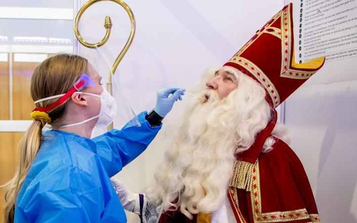 Sinterklaas is being tested for the coronavirus in the XL corona test street at Schiphol, the Netherlands - Shutterstock