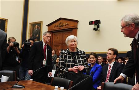 """Federal Reserve Chair Janet Yellen (C) arrives to testify before a House Financial Services Committee hearing on """"Monetary Policy and the State of the Economy."""" at the Rayburn House Office Building in Washington, February 11, 2014. REUTERS/Mary F. Calvert"""