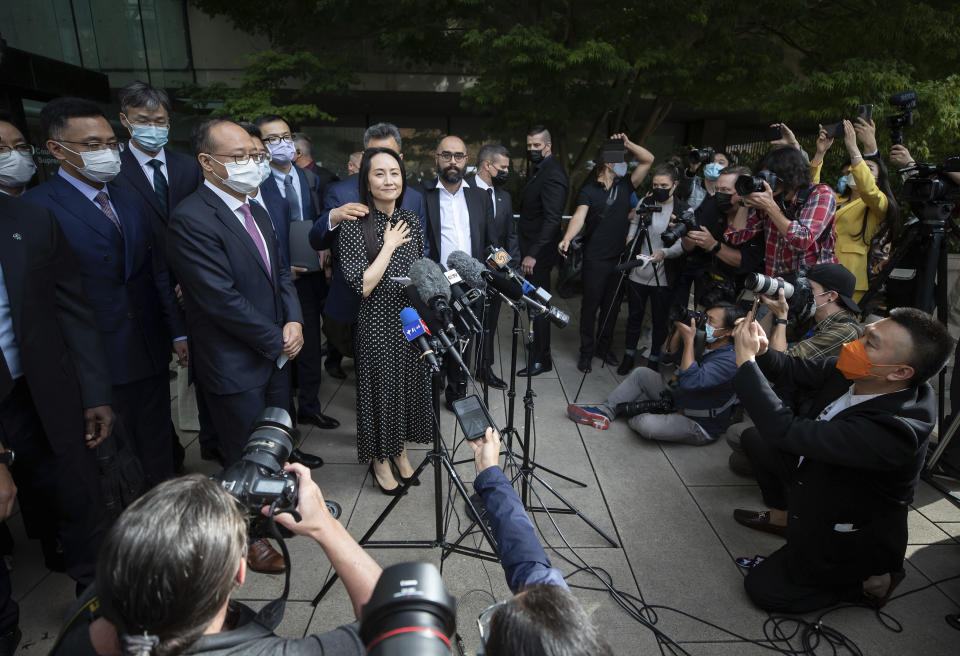 Meng Wanzhou, chief financial officer of Huawei, prepares to read a statement outside B.C. Supreme Court in Vancouver, British Columbia, Friday, Sept. 24, 2021. (Darryl Dyck/The Canadian Press via AP)
