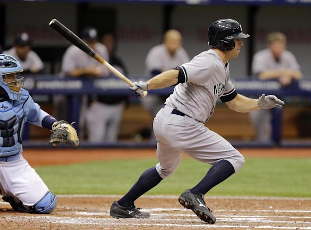 New York Yankees' Brett Gardner lines a two-run single off Tampa Bay Rays starting pitcher Jeremy Hellickson during the fifth inning of a baseball game Sunday, Aug. 17, 2014, in St. Petersburg, Fla. Yankees' Stephen Drew and Martin Prado scored on the hit. Catching for the Rays is Jose Molina. (AP Photo/Chris O'Meara)