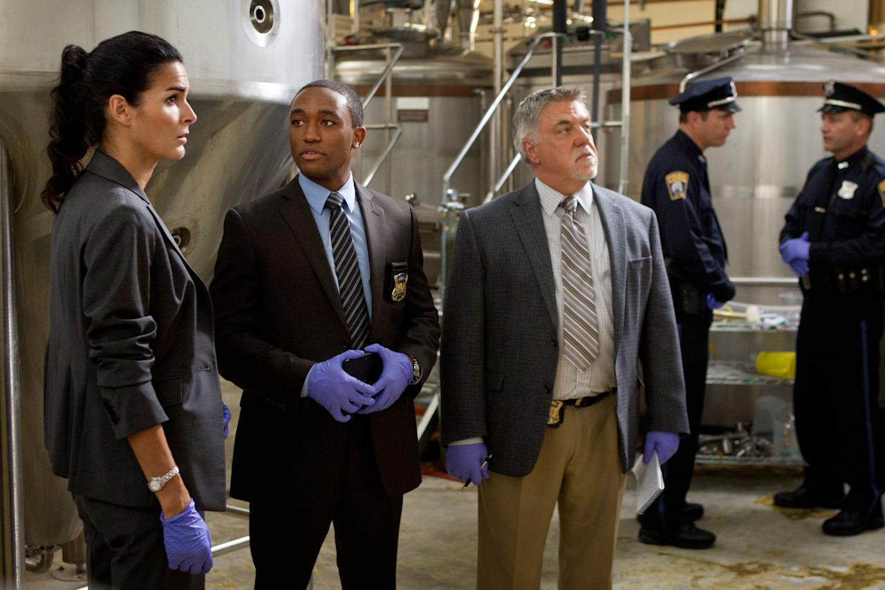 "Angie Harmon, Lee Thompson Young, and Bruce McGill in the ""Rizzoli & Isles"" episode, ""Virtual Love."""