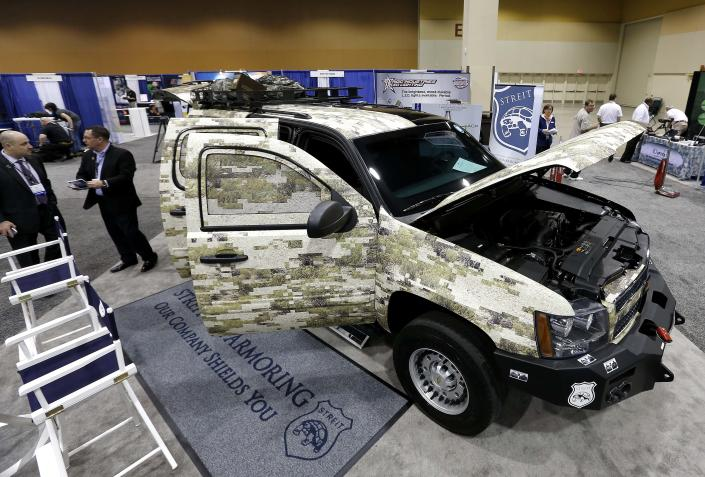 Streit USA Armoring showcases their work Tuesday, March 12, 2013 at the Border Security Expo in Phoenix. More than 180 companies are exhibiting their security products despite automatic spending cuts that are affecting every federal government agency due to the government sequestration. (AP Photo/Matt York)