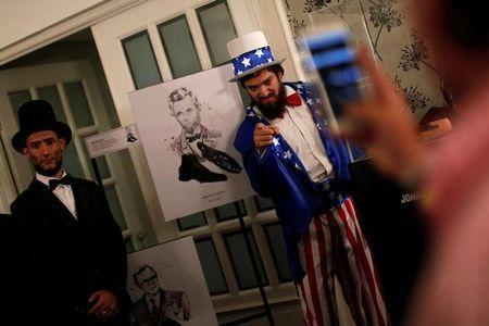 Men in costumes are seen during an event to watch a broadcast of the U.S. presidential race between Democratic nominee Hillary Clinton and Republican nominee Donald Trump in a restaurant in Mexico City, Mexico November 8, 2016. REUTERS/Carlos Jasso