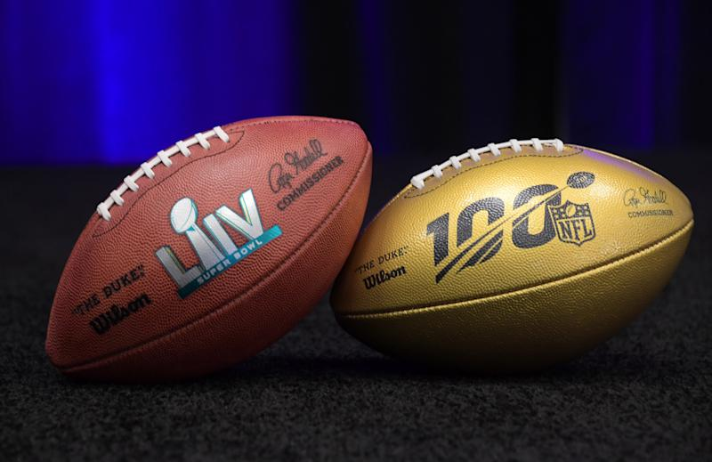 Feb 4, 2019; Atlanta, GA, USA; Detailed view of NFL Wilson gold football to commemorate the league's 100th anniversary and Super Bowl LIV football during the 2019 season at Super Bowl LIII handoff ceremony at Georgia World Congress Center. Super Bowl 54 will be playedi n at Hard Rock Stadium in Miami Gardens, Fla, on Feb. 2, 2020. Mandatory Credit: Kirby Lee-USA TODAY Sports