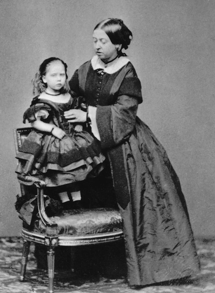 <p>Queen Victoria (1819-1901) had nine children during her reign, which began in 1837. Her first child, also Victoria, was born in 1840, and her youngest, Beatrice (pictured here with her mother) was born 17 years later in 1857. (Photo: Hulton Archive/Getty Images) </p>