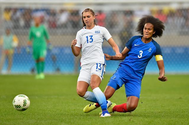<p>Alex Morgan of United States battles for the ball against Wendie Renard of FraFrance during the Women's Group F first round match between United States and France during Day 1 of the Rio 2016 Olympic Games at Mineirao Stadium on August 6, 2016 in Belo Horizonte, Brazil. (Photo by Pedro Vilela/Getty Images) </p>