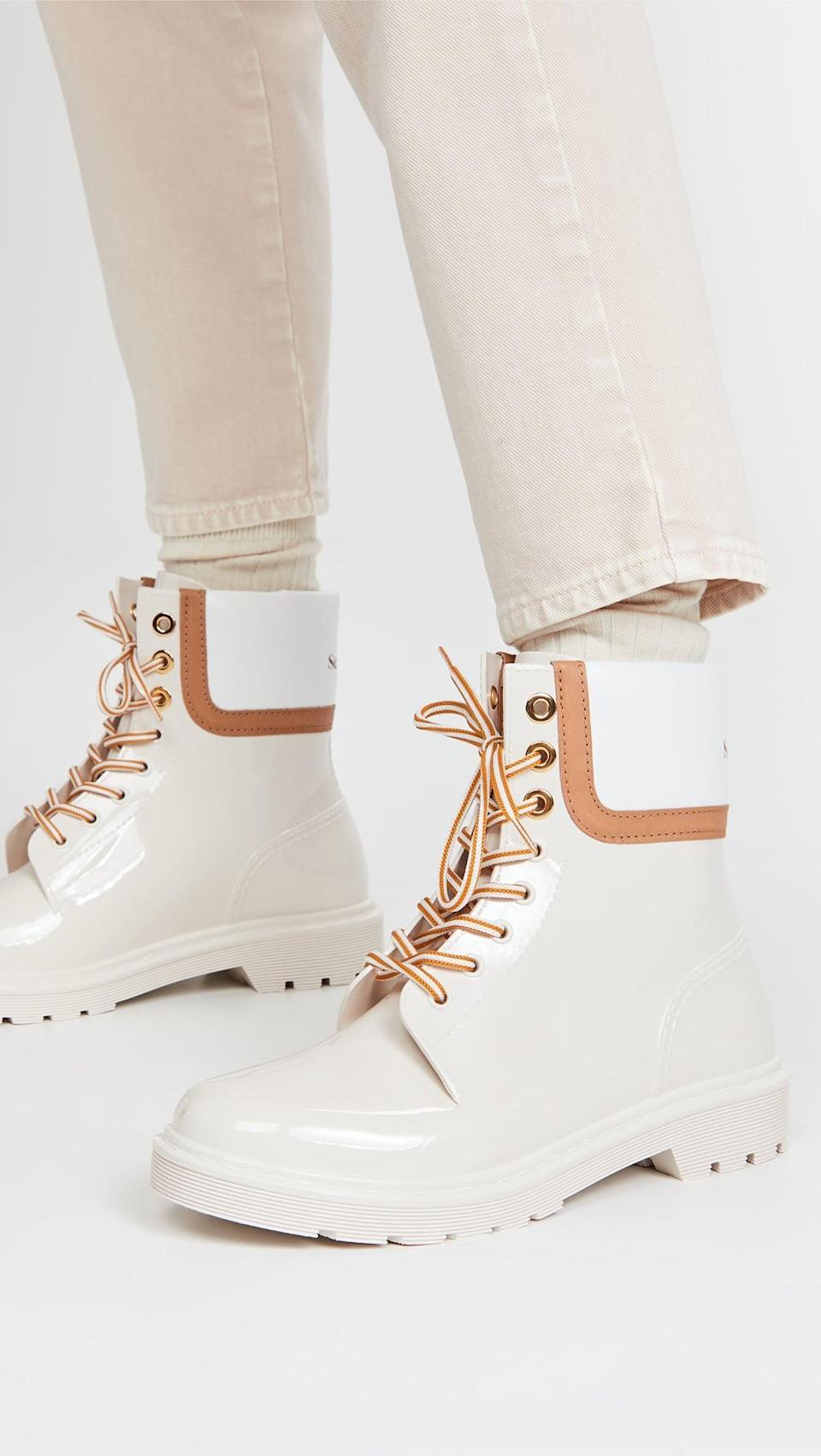 <p>We love the sleek look of these <span>See by Chloe Florrie Lace Up Rain Boots</span> ($250).</p>
