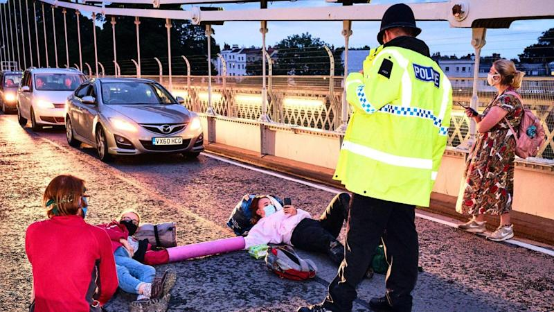 Two arrests after Extinction Rebellion protesters block Bristol bridge