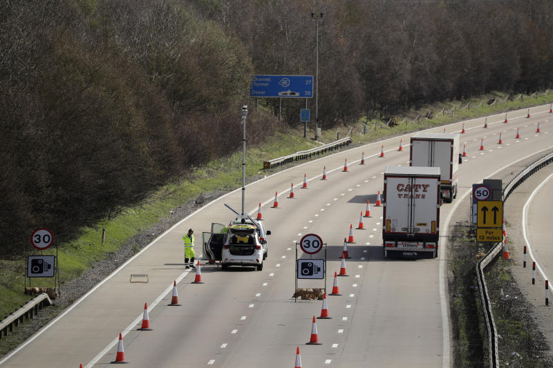On the first day of Operation 'Brock', (Brexit Operations Across Kent) trucks pass through a contraflow system being tested on one side of the M20 motorway near Hollingbourne, Kent, in south east England, Monday, March 25, 2019. The contraflow is designed to manage queues of trucks heading to Europe, via ferries or the Eurotunnel to France, in the event of a no-deal Brexit, to prevent gridlock for other road users. (AP Photo/Matt Dunham)