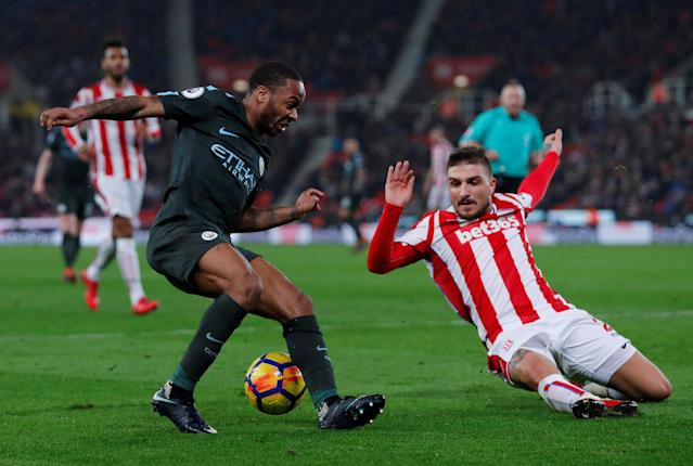 "Soccer Football - Premier League - Stoke City vs Manchester City - bet365 Stadium, Stoke-on-Trent, Britain - March 12, 2018 Stoke City's Kostas Stafylidis in action with Manchester City's Raheem Sterling Action Images via Reuters/Andrew Couldridge EDITORIAL USE ONLY. No use with unauthorized audio, video, data, fixture lists, club/league logos or ""live"" services. Online in-match use limited to 75 images, no video emulation. No use in betting, games or single club/league/player publications. Please contact your account representative for further details."
