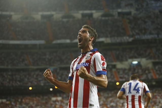 Atletico's Raul Garcia celebrates his goal during a Spanish Supercup first leg soccer match between Real Madrid and Atletico Madrid at Santiago Bernabeu stadium in Madrid, Spain, Tuesday, Aug. 19, 2014. (AP Photo/Andres Kudacki)