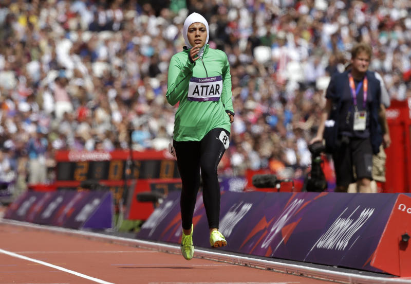Saudi Arabia's Sarah Attar competes in a women's 800-meter heat during the athletics in the Olympic Stadium at the 2012 Summer Olympics, London, Wednesday, Aug. 8, 2012. Attar is the first Saudi woman to compete in athletics during the Olympics. (AP Photo/Anja Niedringhaus)
