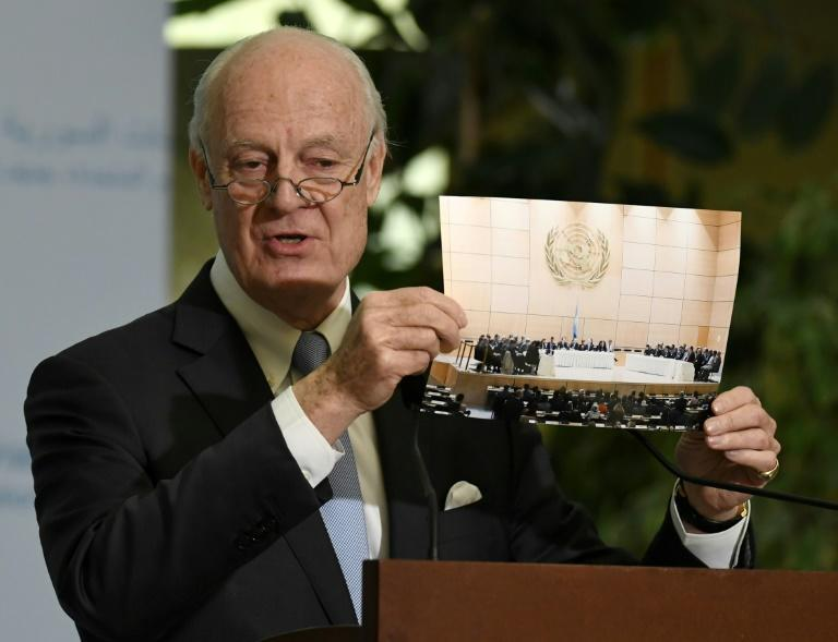 UN Special Envoy of the Secretary-General for Syria Staffan de Mistura shows a picture during a press conference as part of the Intra-Syrian peace talks at the European headquarters of the United Nations in Geneva, on March 3, 2017