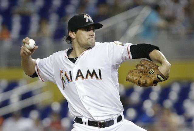 Miami Marlins' Nate Eovaldi delivers a pitch during the first inning of a baseball game against the Washington Nationals, Saturday, Sept. 7, 2013, in Miami. (AP Photo/Wilfredo Lee)