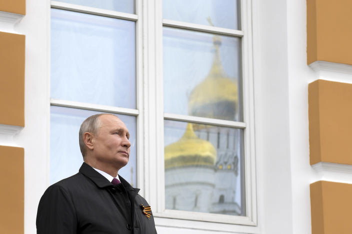 Russian President Vladimir Putin watchs a military flyover of Red Square by 75 warplanes and helicopters marking the 75th anniversary of the Nazi defeat in World War II in Moscow, Russia, Saturday, May 9, 2020. Putin cancelled a massive Victory Day marking the 75th anniversary of the Nazi defeat in World War II but ordered a flyby of warplanes over Red Square. (Alexei Druzhinin, Sputnik, Kremlin Pool Photo via AP)