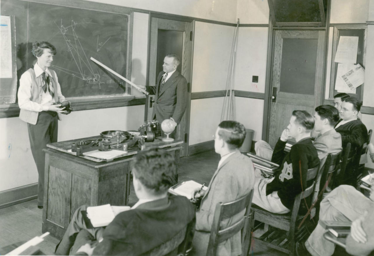 FILE - This undated photo shows Amelia Earhart visting a Purdue classroom for aerodynamics students. Earhart was a lecturer at the school from fall of 1935 until her 1937 disappearance. Three bone fragments found on a deserted South Pacific island are being analyzed to determine if they belong to Amelia Earhart _ tests that could finally prove she died as a castaway after failing in her 1937 quest to become the first woman to fly around the world.