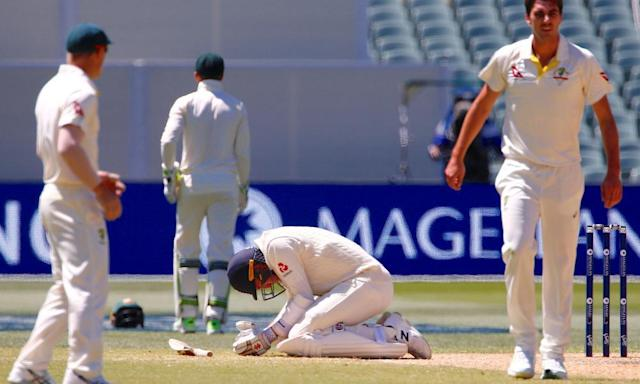 "<span class=""element-image__caption"">Craig Overton after being hit in the ribcage by a delivery from Australia's Pat Cummins during the fifth day of the second Ashes Test in Adelaide. </span> <span class=""element-image__credit"">Photograph: David Gray/Reuters</span>"