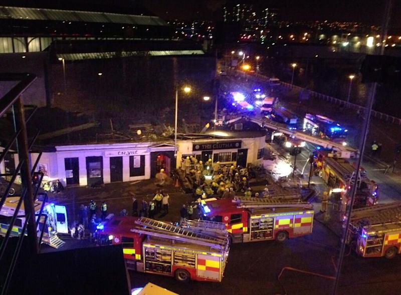 Picture taken with permission from Jan Hollands Twitter feed JanHollands@Janney_h of the helicopter crash at the Clutha Bar in Glasgow Friday Nov. 29, 2013. The police helicopter crashed late Friday night into the roof of a popular pub in Glasgow, Scotland, leaving the building littered with debris and emergency crews scrambling to the scene. (AP Photo/Jan Hollands via PA) UNITED KINGDOM OUT - NO SALES - NO ARCHIVES