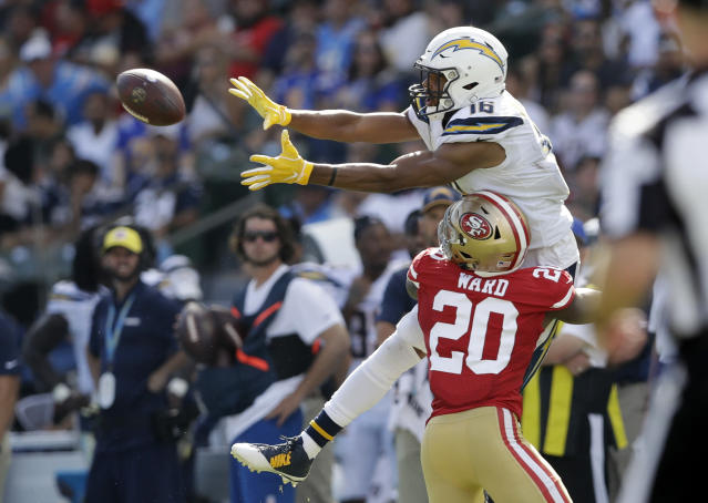 <p>Los Angeles Chargers wide receiver Tyrell Williams, top, makes a catch while under pressure from San Francisco 49ers defensive back Jimmie Ward during the second half of an NFL football game, Sunday, Sept. 30, 2018, in Carson, Calif. (AP Photo/Marcio Sanchez) </p>