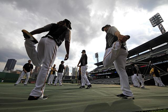 Pittsburgh Pirates' Andrew McCutchen, left, and Gaby Sanchez, right, stretch during a baseball workout in Pittsburgh, Saturday, Oct. 5, 2013. The Pirates are scheduled to host the St. Louis Cardinals in Game 3 of the National League division series on Sunday. (AP Photo/Gene J. Puskar)