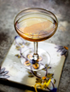 "<p><strong>Ingredients</strong></p><p>2.5 oz rye whiskey<br>.25 oz green Chartreuse<br>.5 oz simple syrup<br>Absinthe rinse<br>2 dashes lemon bitters<br>Lemon twist</p><p><strong>Instructions</strong></p><p>Add a splash of absinthe into a coupe glass and swirl to lightly coat the inside of the glass. Discard absinthe. In a mixing glass, stir rye, Chartreuse, and syrup over ice. Strain into the coupe glass, top with lemon bitters, and garnish with lemon twist.</p><p><em>From <a href=""http://spicekitchenandbar.com/"" rel=""nofollow noopener"" target=""_blank"" data-ylk=""slk:Spice Kitchen and Bar"" class=""link rapid-noclick-resp"">Spice Kitchen and Bar</a> in Cleveland.</em></p>"
