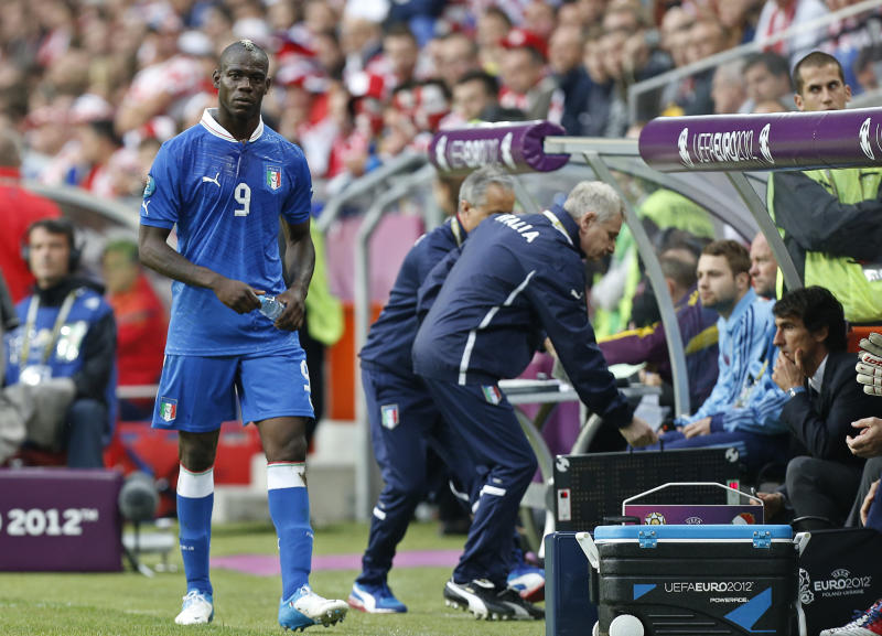 FILE - The June 14, 2012 file photo shows Italy's Mario Balotelli leaving the pitch after being substituted during the Euro 2012 soccer championship Group C match between Italy and Croatia in Poznan, Poland. UEFA has charged the Croatian football federation with its fans' bad behavior. (AP Photo/Jon Super)