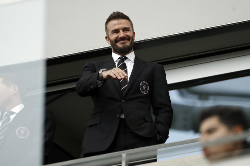 David Beckham waves from the stands before an MLS soccer match between Los Angeles FC and Inter Miami CF Sunday, March 1, 2020, in Los Angeles. (AP Photo/Marcio Jose Sanchez)