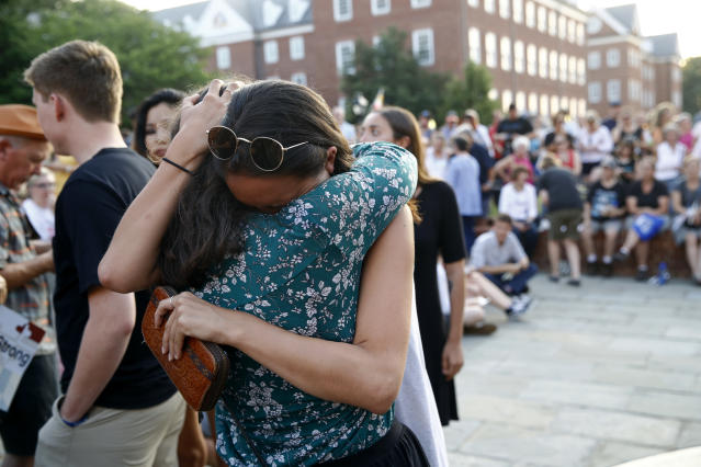 <p>People hug as they gather for a vigil in response to a shooting in the Capital Gazette newsroom, Friday, June 29, 2018, in Annapolis, Md. (Photo: Patrick Semansky/AP) </p>