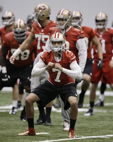 San Francisco 49ers quarterback Colin Kaepernick (7) stretches with teammates during practice on Friday, Feb. 1, 2013, in New Orleans. The 49ers are scheduled to play the Baltimore Ravens in the NFL Super Bowl XLVII football game on Feb. 3. (AP Photo/Mark Humphrey)