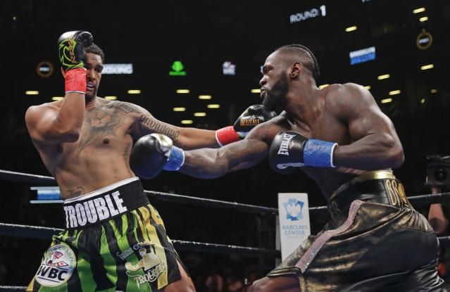 Dominic Breazeale, left, evades a right from Deontay Wilder during the first round of the WBC heavyweight championship boxing match Saturday, May 18, 2019, in New York. Wilder won in the first round.(AP Photo/Frank Franklin II)