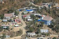 Houses are seen on the Myanmar side of the border at Zokhawthar in India's northeastern state of Mizoram