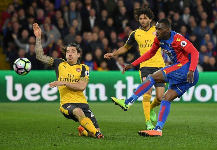 Christian Benteke of Crystal Palace shoots past Hector Bellerin of Arsenal