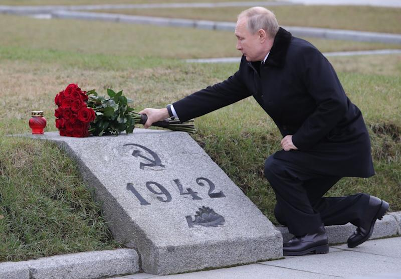 Russian President Vladimir Putin attends a wreath laying commemoration ceremony for the 75th anniversary since the Leningrad siege was lifted during World War Two, at the Bounday Stone east of Saint Petersburg on 18 January: Sputnik/AFP via Getty Images