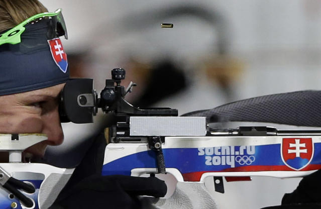 Slovakia's Anastasiya Kuzmina shoots on her way to win the gold medal in the women's biathlon 7.5k sprint, at the 2014 Winter Olympics, Sunday, Feb. 9, 2014, in Krasnaya Polyana, Russia. (AP Photo/Lee Jin-man)