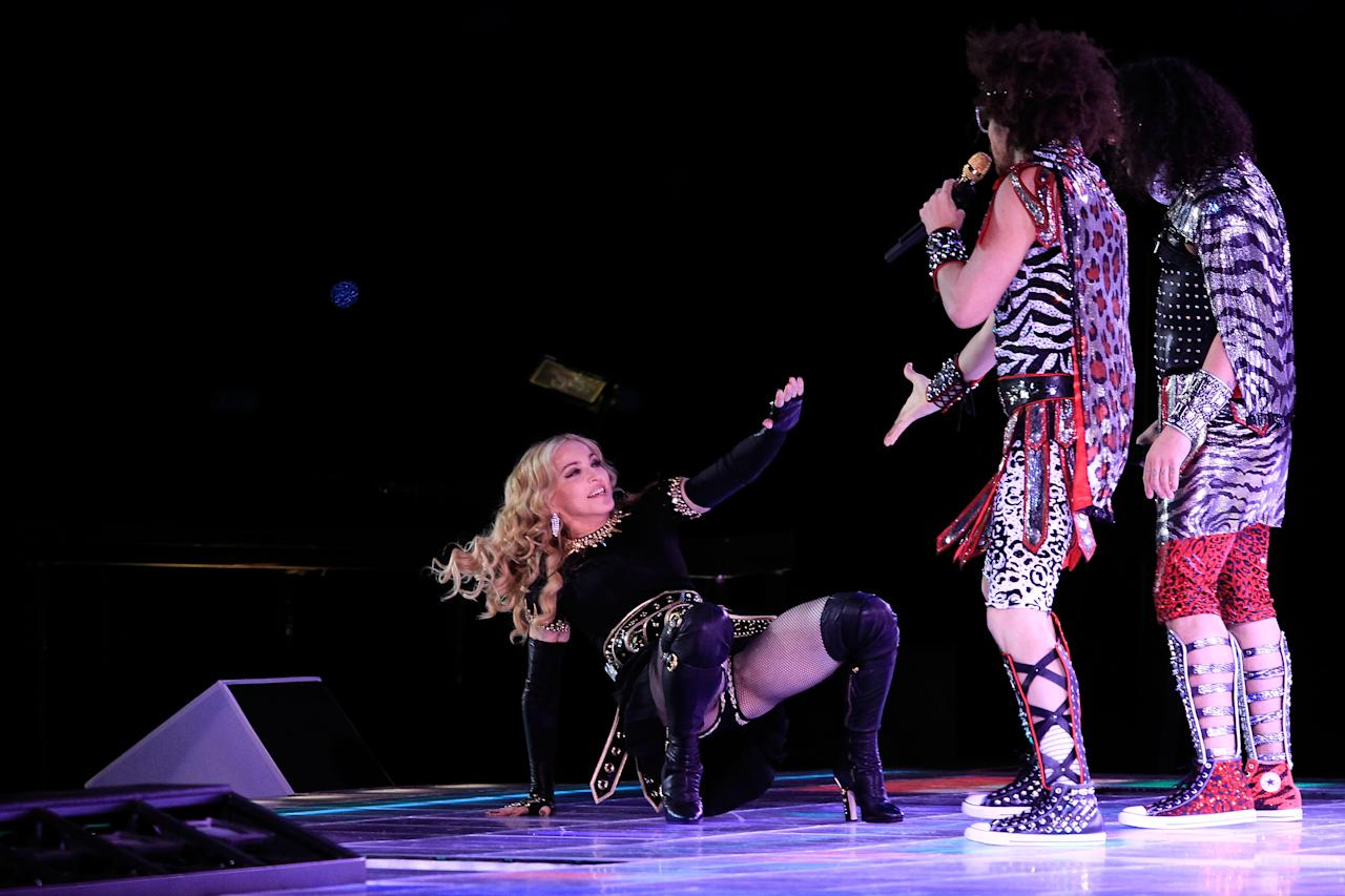 INDIANAPOLIS, IN - FEBRUARY 05:  Singer Madonna performs with Redfoo and Sky Blu of LMFAO during the Bridgestone Super Bowl XLVI Halftime Show at Lucas Oil Stadium on February 5, 2012 in Indianapolis, Indiana.  (Photo by Chris Trotman/Getty Images)