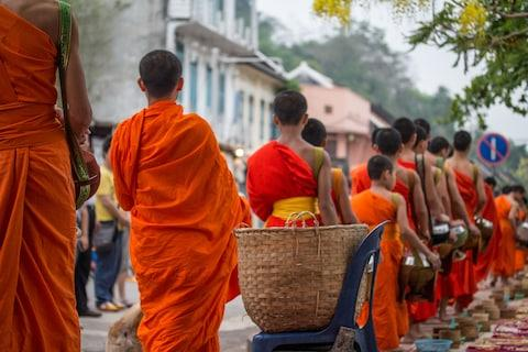 Monks collecting alms - Credit: GETTY