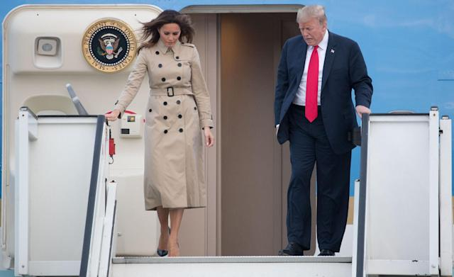 <p>Arriving in Belgium for a tour of Europe, Melania Trump stepped off the plane beside the President wearing a £1,510 Burberry trench coat, buttoned right up to the neck.<br><em>[Photo: Rex]</em> </p>