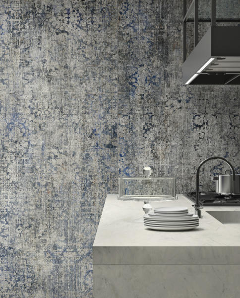 This undated photo shows Del Conca's Timeline collection, which puts the look of distressed vintage carpet on tile. (Ceramics of Italy via AP)