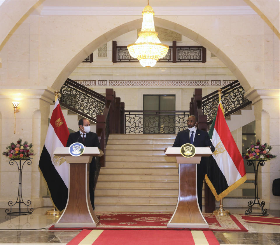 Egyptian President Abdel Fattah al-Sisi meets Chairman of the Sovereignty Council of Sudan Gen. Abdel Fattah Abdelrahman al-Burhan at the Presidential Palace in Khartoum, Sudan, Saturday, March. 6, 2021. Egypt's presidency says President Abdel Fattah el-Sissi trip was to address an array of issues, including economic and military ties and the two nations' dispute with Ethiopia over a massive dam Addis Ababa is building on the Blue Nile. The visit comes amid a rapprochement between the two governments. (Presidency of Sudan via AP)