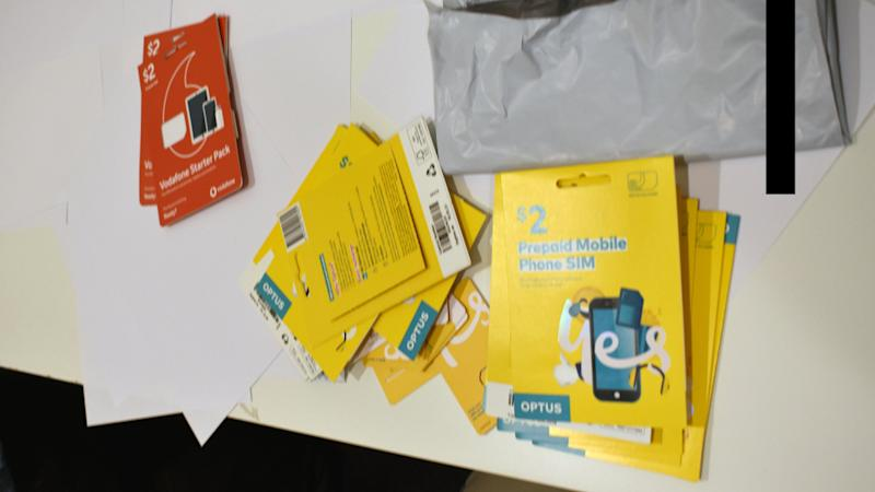 Vodafone and Optus SIM cards allegedly used for identity theft.