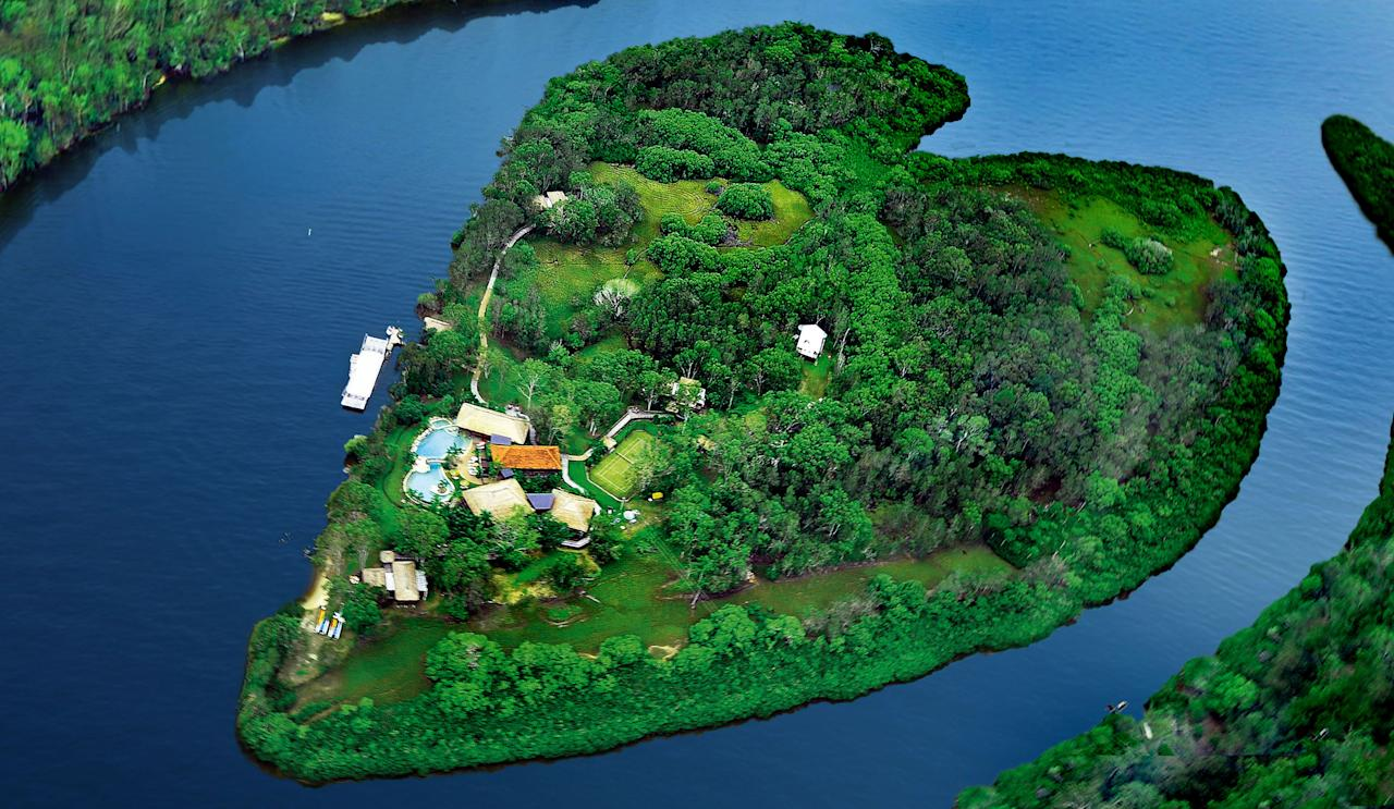 PIC FROM MAKEPEACE ISLAND / CATERS NEWS - (A heart shaped makepeace island off Australias Sunshine Coast) With Valentines Day just around the corner its the time of year when love is in the air but as these pictures prove - its all over the earth too. These extraordinary images, taken by photographers across the globe, show Mother Nature is also gearing up to celebrate the big day with iconic heart shapes appearing all over the natural world. The charming pictures capture Mother Natures romantic side and feature several signs of love including an adorable fluffy penguin with a white heart emblazoned on its chest. Other natural displays include a flamingo creating a heart shape with its white and pink plumage and two swans which appear to kiss as they form a heart shape with their necks. SEE CATERS COPY