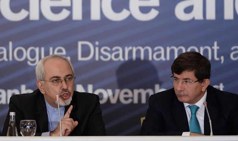 Iran's new Foreign Minister Mohammad Javad Zarif, left, speaks during a forum with his Turkish counterpart Ahmet Davutoglu, right, in Istanbul, Turkey, Friday, Nov. 1, 2013. Zarif said that both Iran and the West need a new approach if negotiations on Iran's nuclear program are to succeed. Speaking at a conference on disarmament in Istanbul, Zarif said that a decade of failed negotiations have led to consequences neither side wanted.(AP Photo)