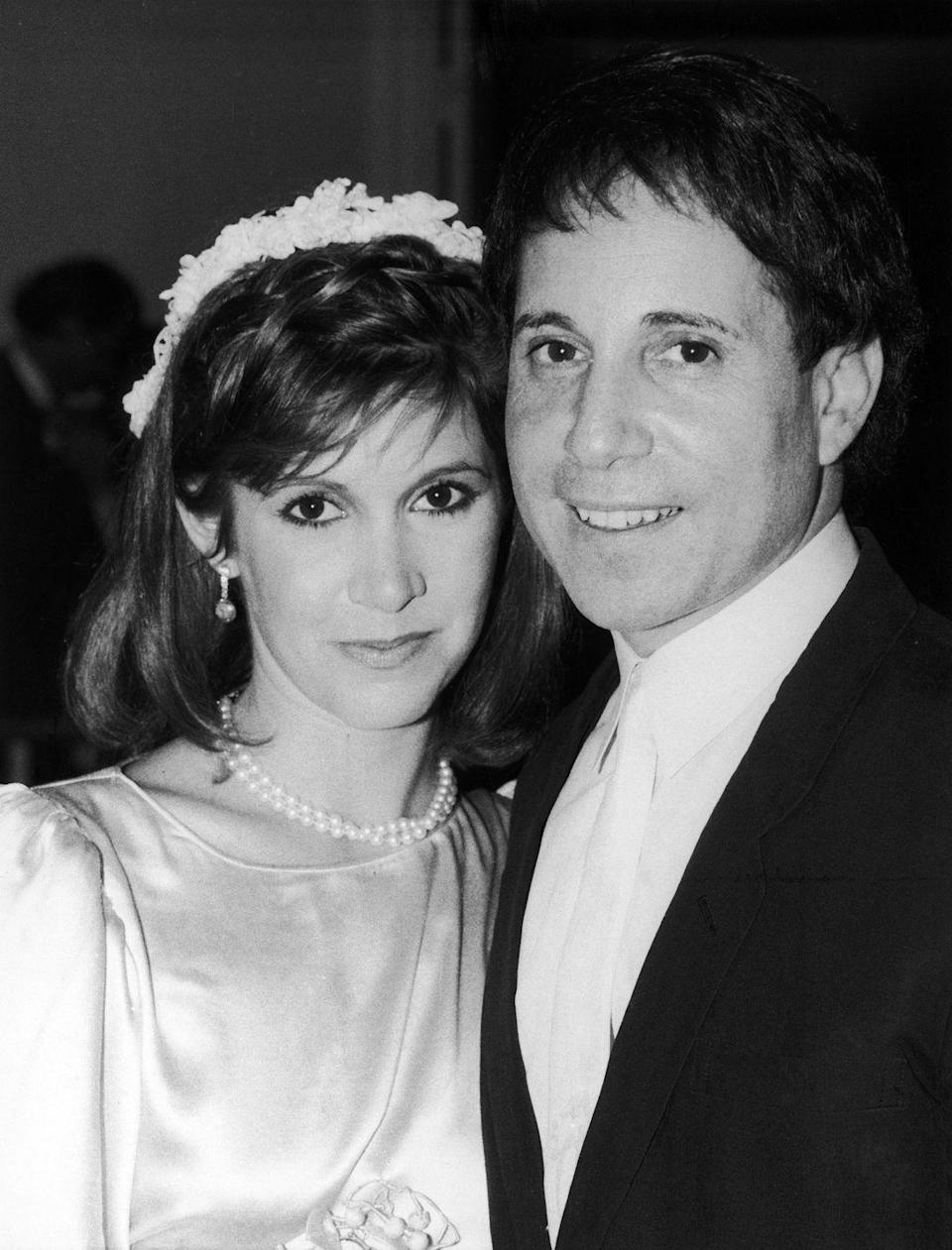 """<p>Late actress Carrie Fisher <a href=""""http://www.eonline.com/news/818391/carrie-fisher-s-ex-paul-simon-pays-tribute-to-her-after-her-death-inside-their-turbulent-relationship"""" rel=""""nofollow noopener"""" target=""""_blank"""" data-ylk=""""slk:married singer Paul Simon"""" class=""""link rapid-noclick-resp"""">married singer Paul Simon</a> in August 1983, only to get quickly divorced the next summer due to issues with substance abuse. The relationship between the two was turbulent, and they continued to date on-and-off after their divorce. </p>"""