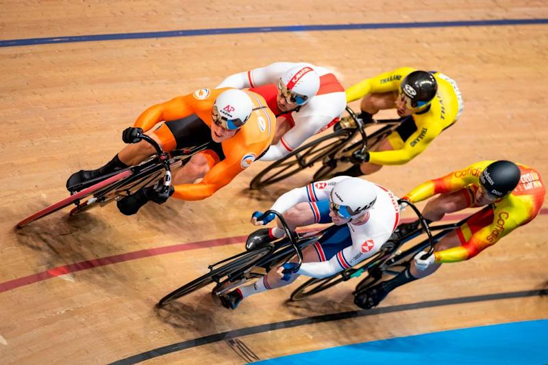 Netherlands Jeffrey Hoogland L and Great Britains Jason Kenny C compete in the Kerin first round during the UCI track cycling World Championship at the velodrome in Berlin on February 27 2020 Photo by Odd ANDERSEN AFP Photo by ODD ANDERSENAFP via Getty Images