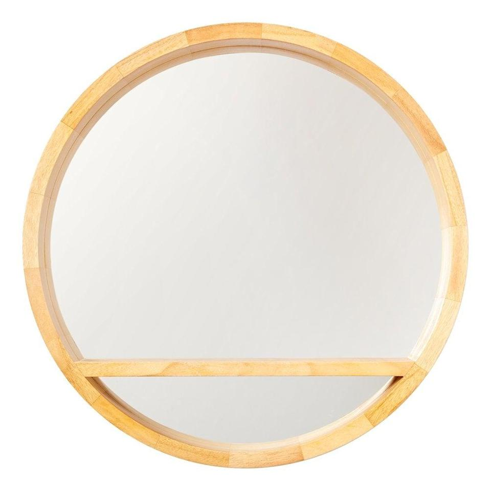 <p>This <span>Drew Barrymore Flower Home Round Wood Mirror with Shelf</span> ($59) is so unique.</p>
