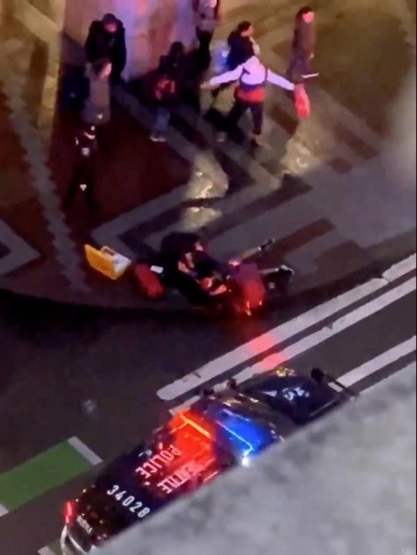 Police and emergency officials attend to the injured following a shooting in Seattle