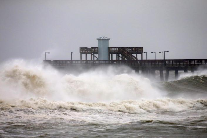 Waves crash along a pier as Hurricane Sally approaches in Gulf Shores, Alabama, in the US. Photo: Jonathan Bachman/Reuters